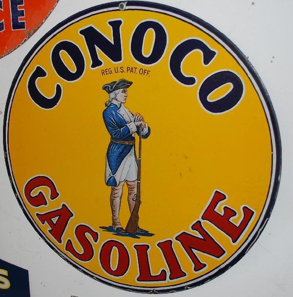 66: Conoco Gasoline with Minuteman logo,  DSP sign,  26
