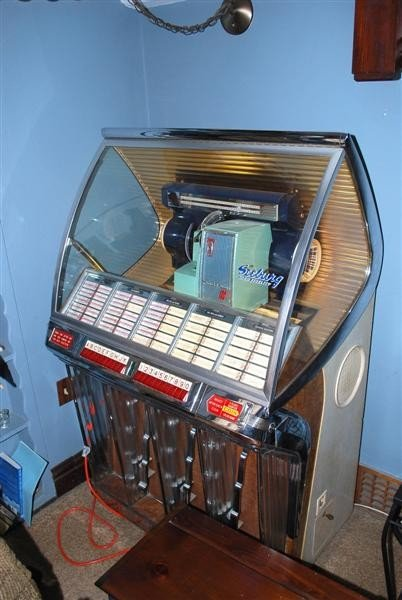 74B: Seeburg Model #100 Juke Box, full of records,