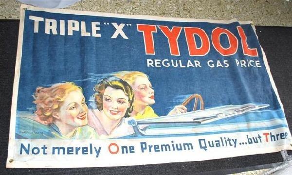 19: Tydol Regular Gas Price with three ladies in car by