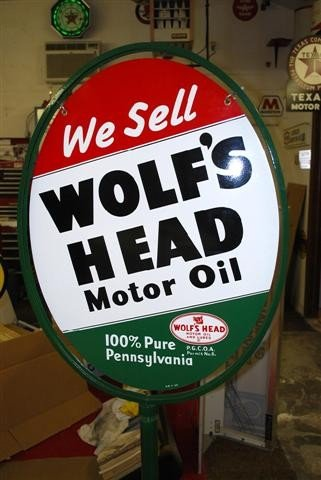 51: We Sell Wolf's Head Motor Oil with logo,  DST oval