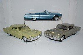 1024: 3-1964 Thunderbird promo cars, silver is a radio,