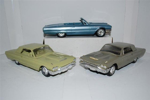 1024: 3-1964 Thunderbird promo cars, silver is a radio,