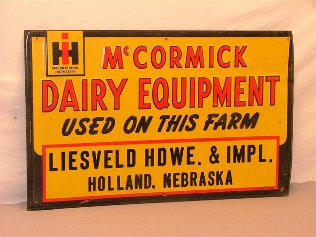 """12: IH McCormick Dairy Equipment sign """"Used on this far"""