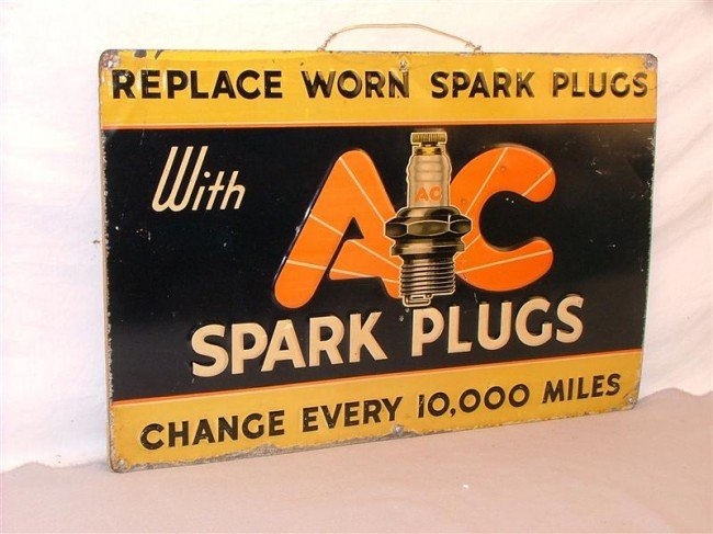 18: AC Spark Plugs  mounted on wood backing SST embosse