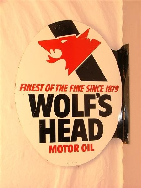 22: Wolf's Head Motor Oil DST flange sign 22x17