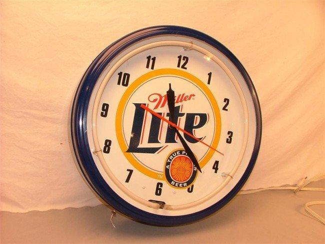27: New Miller Lite  neon clock 19 inches