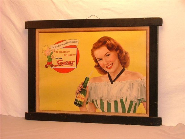 33A: Squirt  cardboard sign with wooden frame 22x30