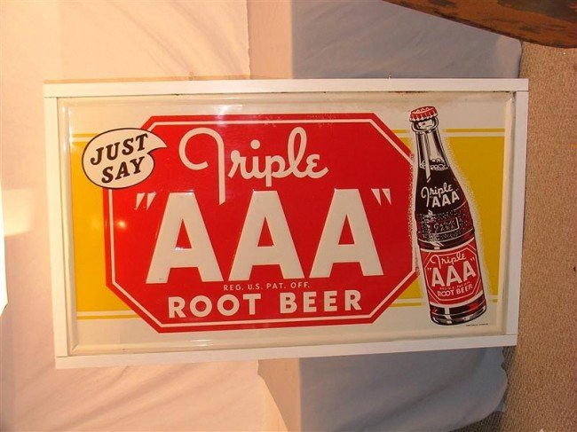 "44: Triple ""AAA"" Root Beer  Embossed SST sign on wooden"