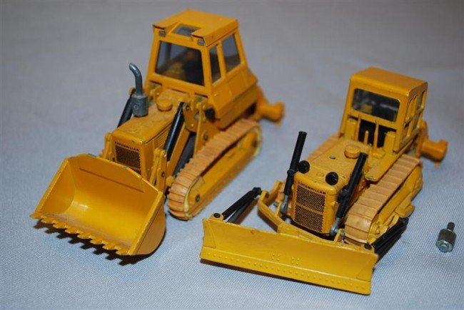 12: 2-NZG Caterpillars Track Loader and Dozer both with