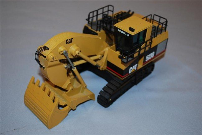 13: NZG Caterpillar 5130 Track Shovel with cab, diecast
