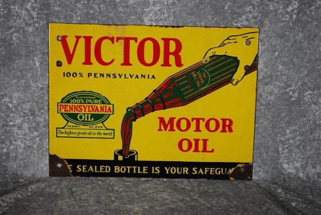 """7: Victor Motor Oil """"100% Pennsylvania"""" with oil pourin"""