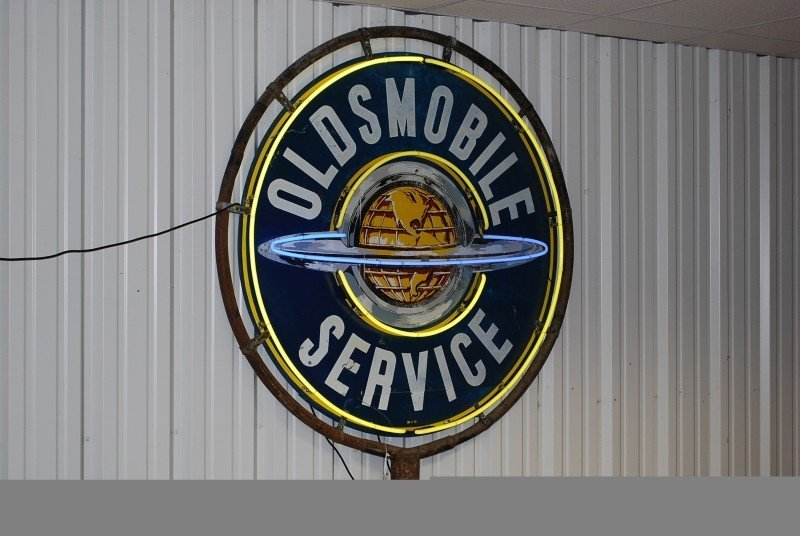 88: Oldsmobile Service with world logo, DSP sign, 54 in