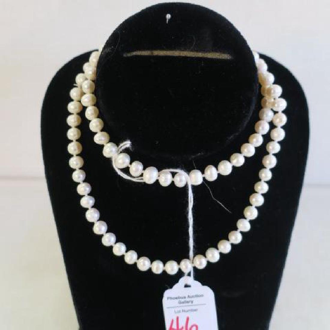 "26"" Strand of Hand knotted Cultured Pearls:"