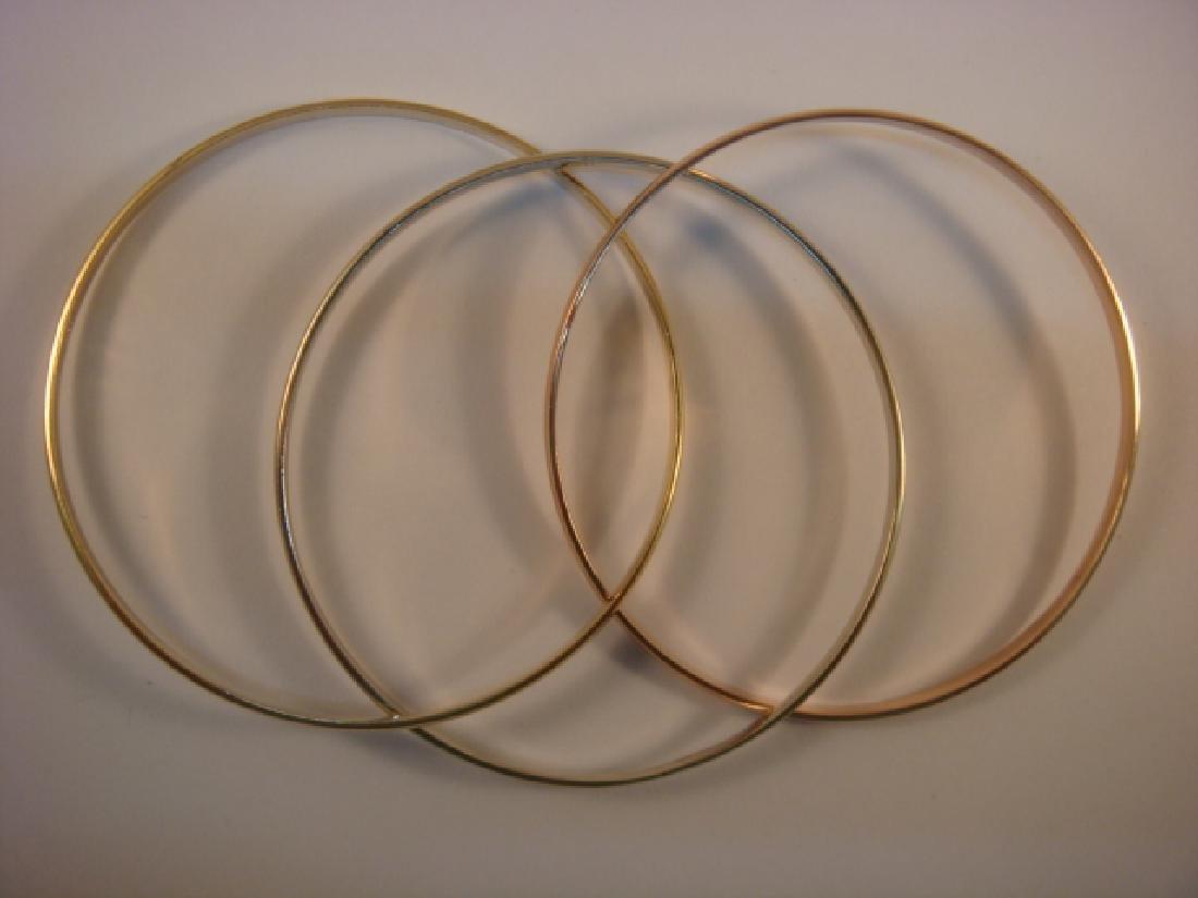 14 KT Set Three Interlocking Plain Bangle Bracelets: