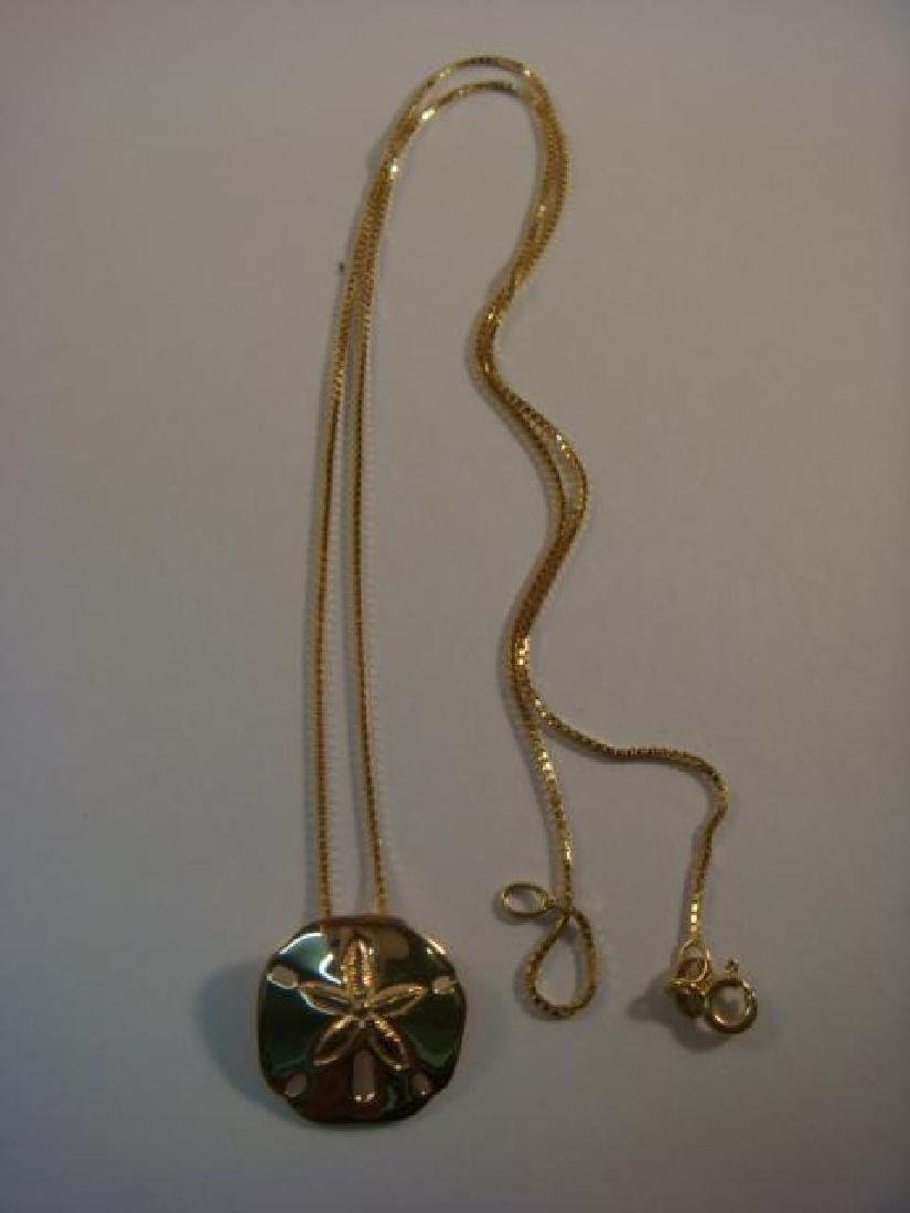 14 KT Gold Lady's Necklace with Sand Dollar Pendant: