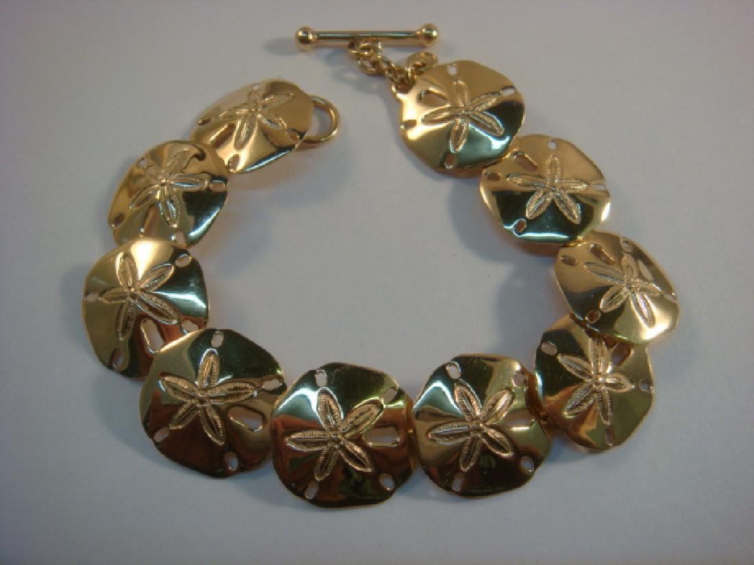 14 KT Gold Repetitive Link Bracelet of Sand Dollars.