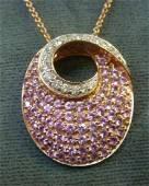 14 KT Gold Diamond & Sapphire Swirl Pendent on Chain: