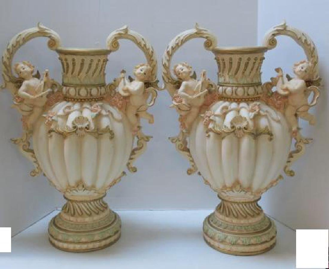 Pair of Tall Lobed Double Handled Vases with Cherubs:
