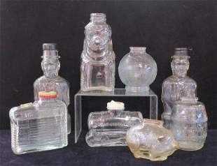 Eight Clear Glass Bottle and Advertising Banks