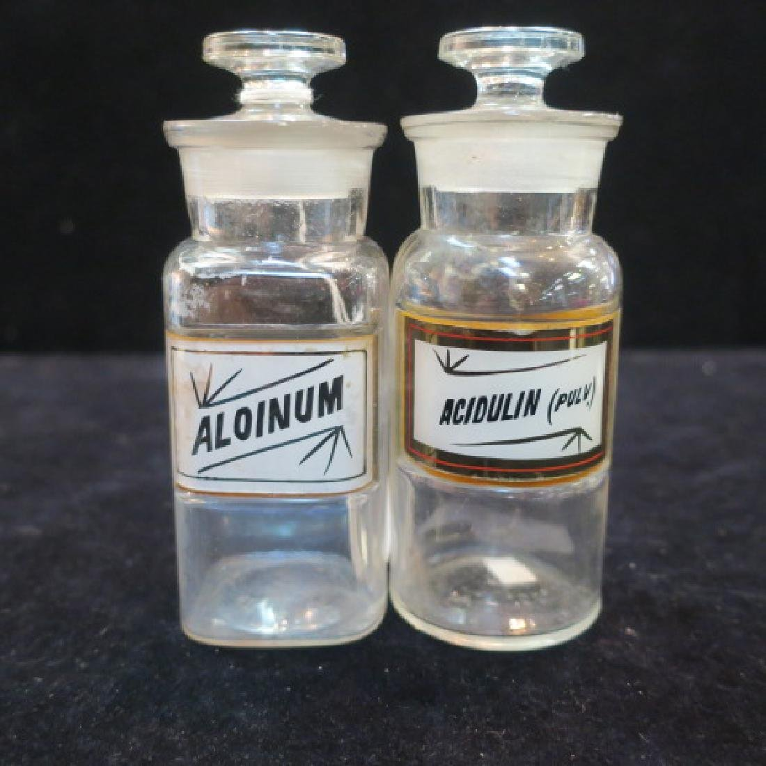 Two Antique Apothecary Bottles with Stoppers: