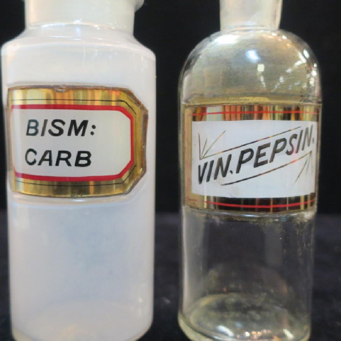 Two Apothecary Bottles; VIN.PEPSIN. & BISM:CARB: - 2