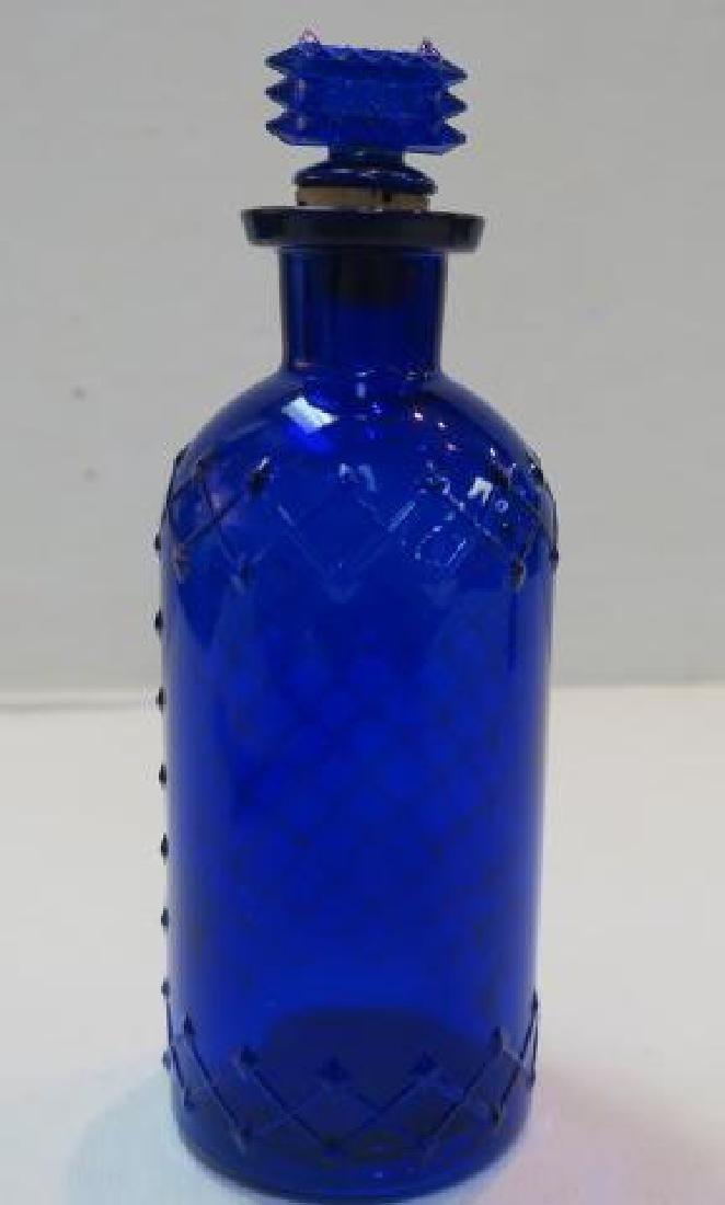 POISON BOTTLE, COBALT Bottle with Embossed Sides: