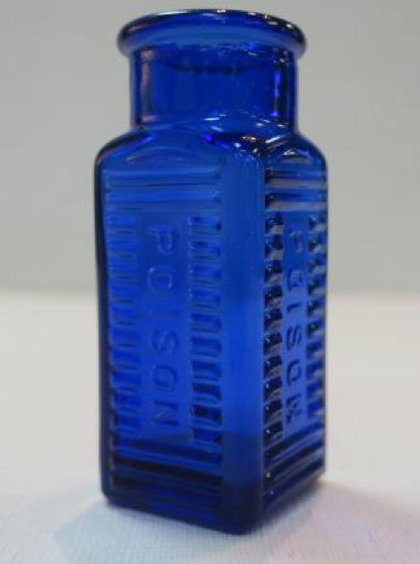 POISON BOTTLE, COBALT Bottle Embossed on Two Sides: