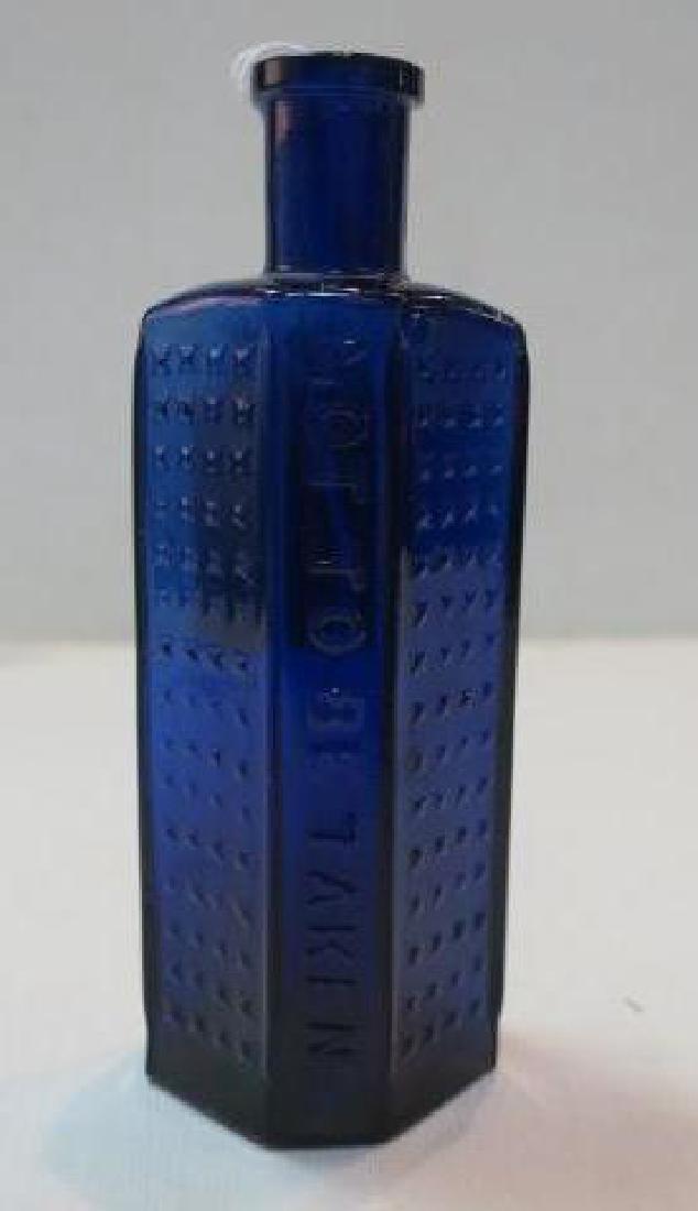 POISON BOTTLE, COBALT Bottle Embossed Stars 2 Sides: