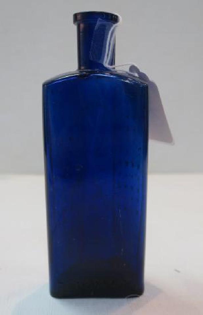 POISON BOTTLE, COBALT Bottle Embossed Stars 2 Sides: - 4