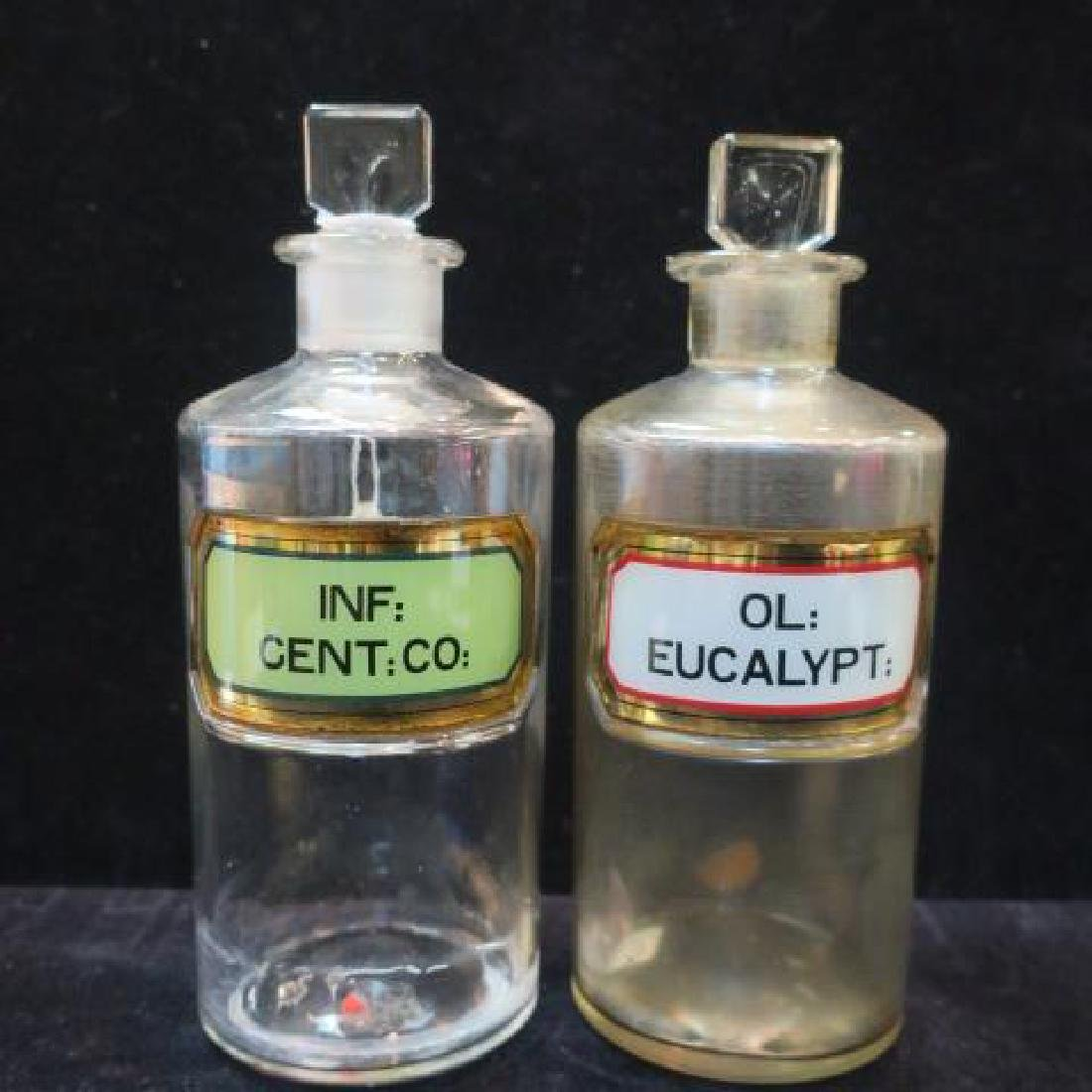 "Two Vintage 8"" Pharmacy Bottles with Square Stoppers:"