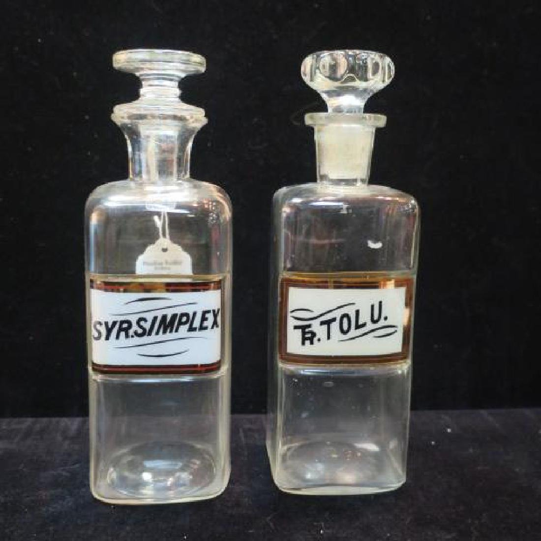 "Two Antique 8 1/2"" Pharmacy Bottles with Stoppers:"