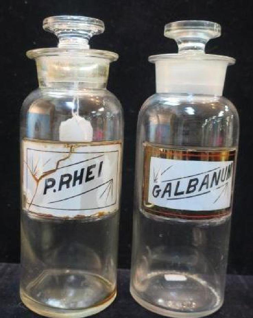 "Two Antique 8"" Pharmacy Bottles with Glass Stoppers:"