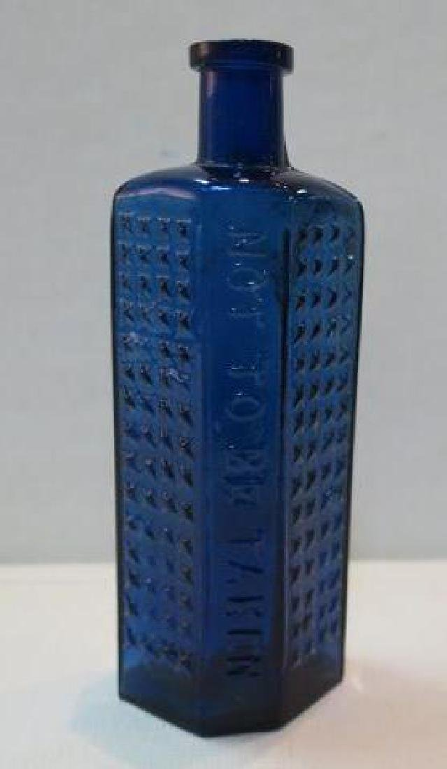 POISON BOTTLE, COBALT Bottle Embossed Stars 2 Sides: