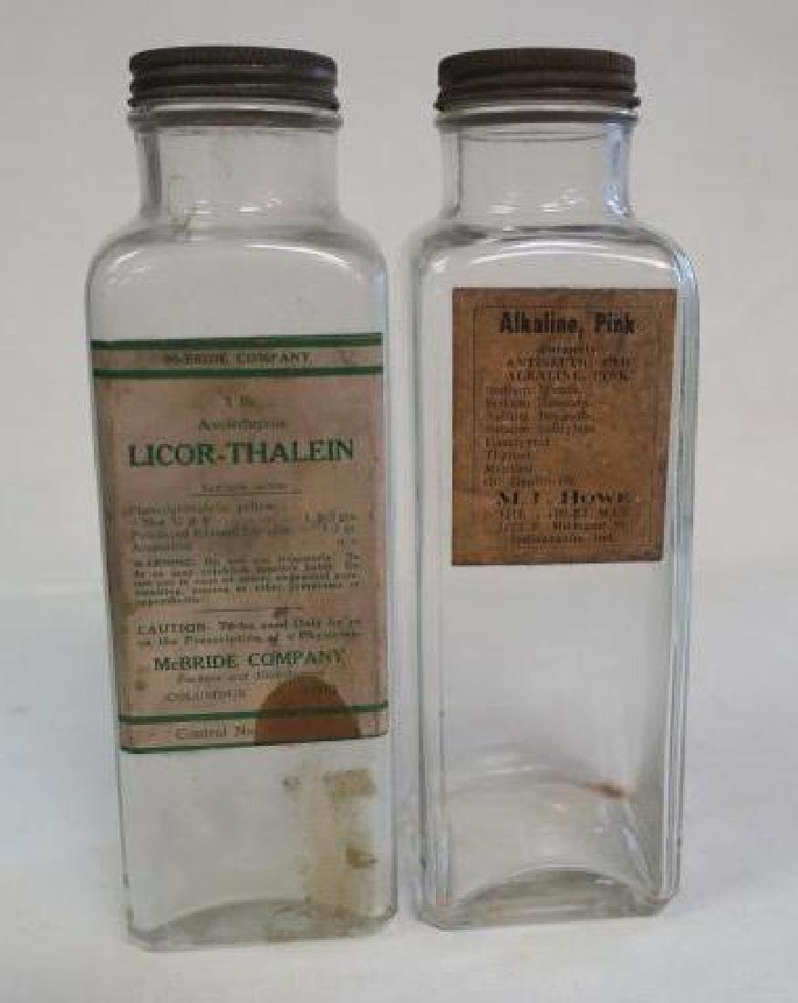 Two Vintage Clear Glass Pharmacy Dispensing Bottles: