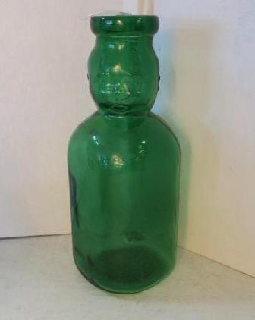 Green Glass Face Bottle: