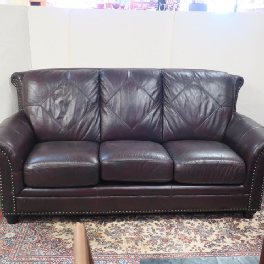Three Cushion Leather Diamond Back Upholstered Sofa: