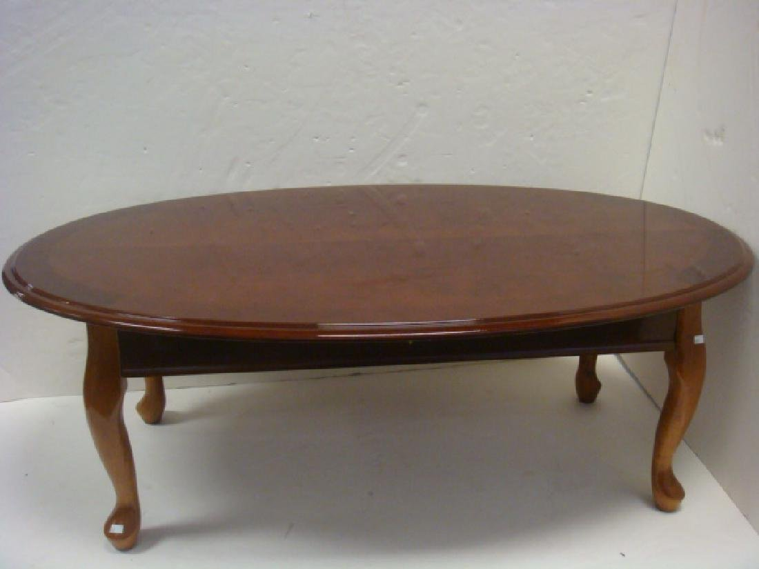 Oval Mahogany Cocktail Table with Polished Finish: