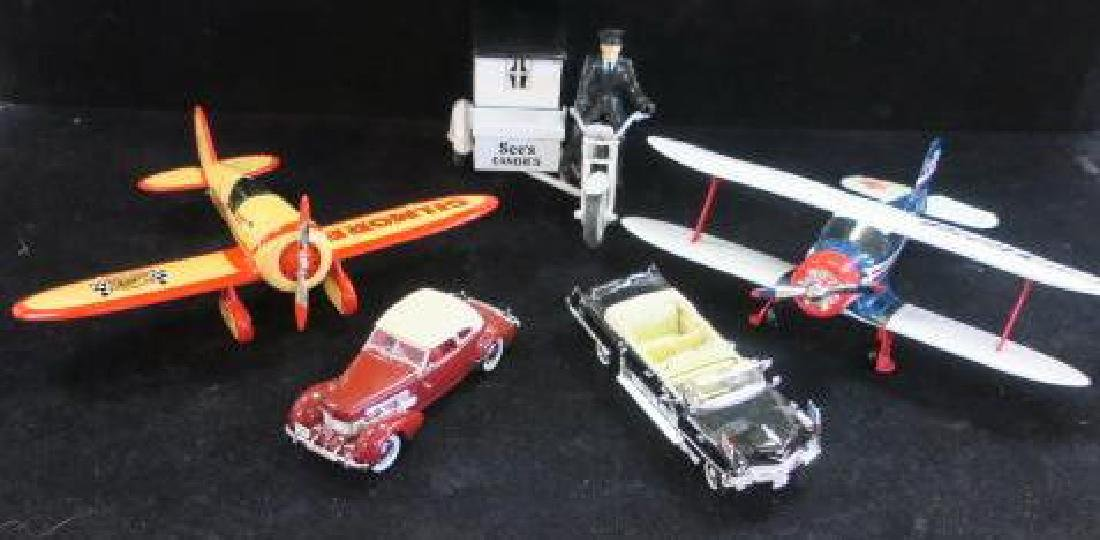 Two Model Cars, 2 Airplanes and a Motorcycle: