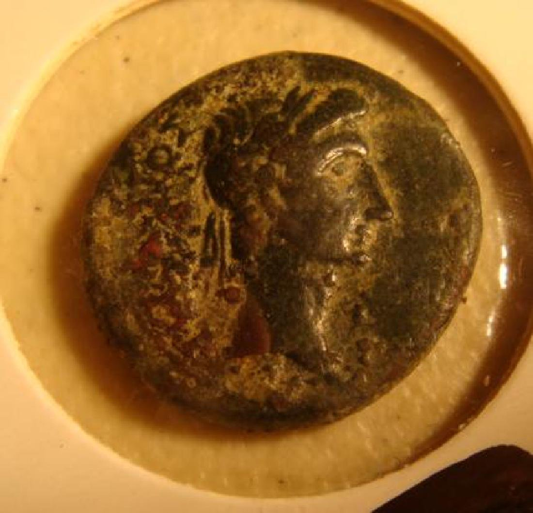 ANCIENT GREEK BRONZE COIN FEATURING ATHLETE/GOD: