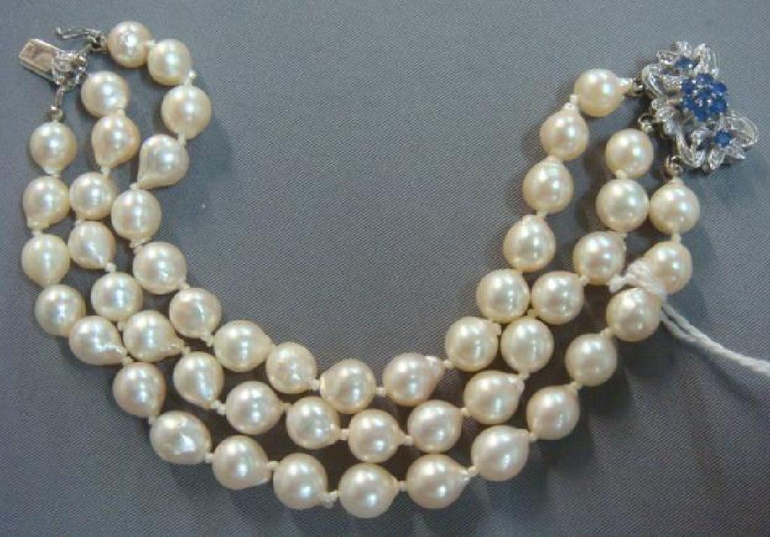 Triple Strand Freshwater Pearl Bracelet: - 5