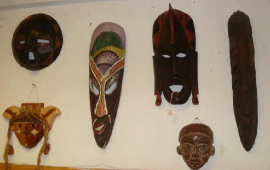 Collection of Seven African Masks and Figure: