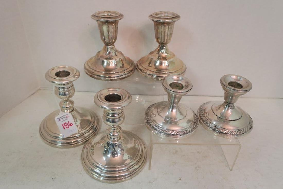 Three Pairs of Sterling Silver Candlesticks: