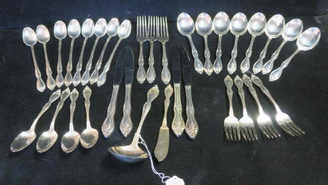 Partial Set of Rogers/Oneida Silver Plate Flatware: