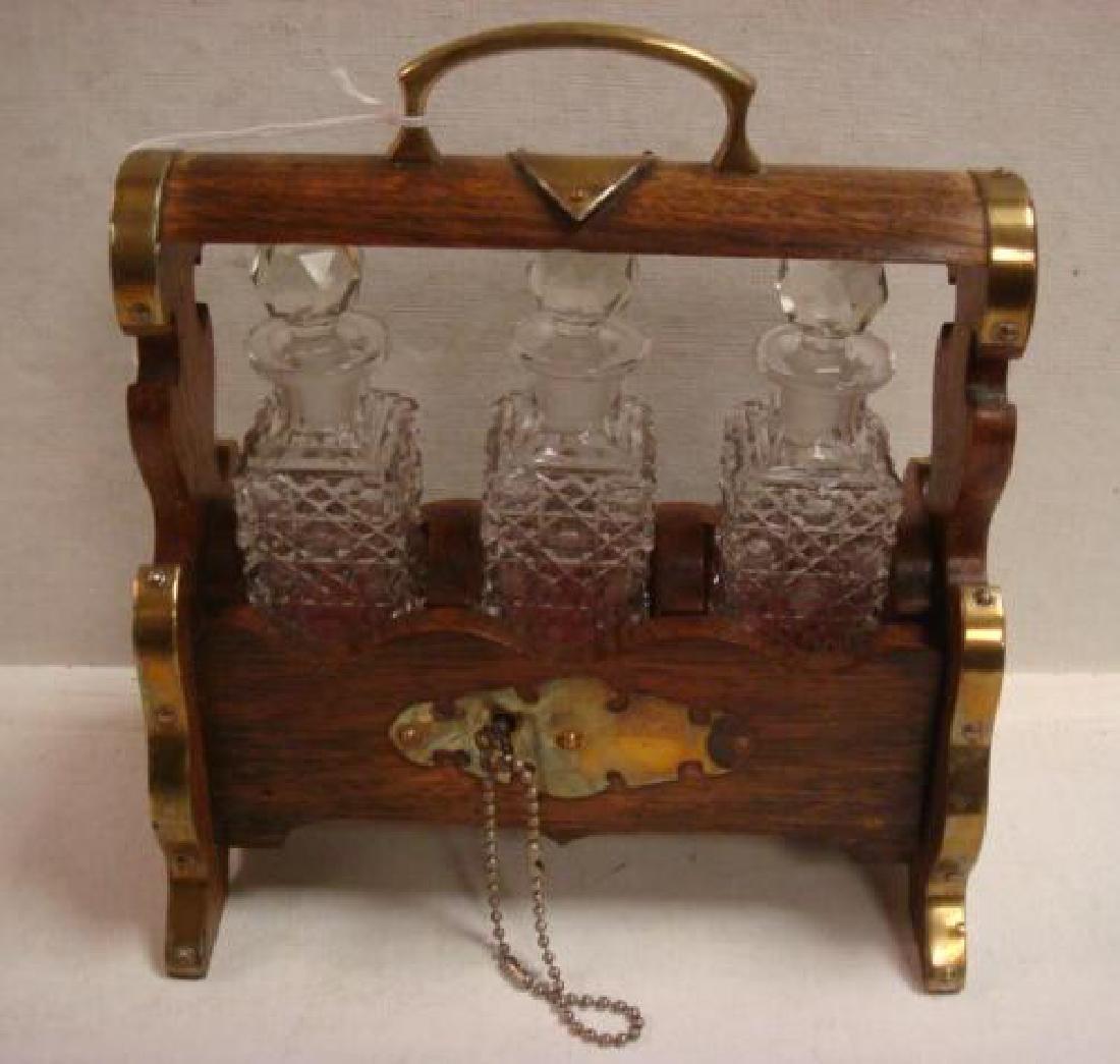Oak and Brass Tantalus Holding Three Bottles: