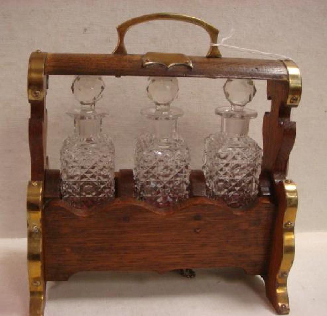 Oak and Brass Tantalus Holding Three Bottles: - 2