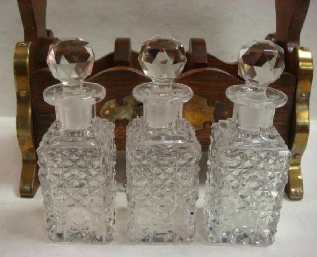 Oak and Brass Tantalus Holding Three Bottles: - 3