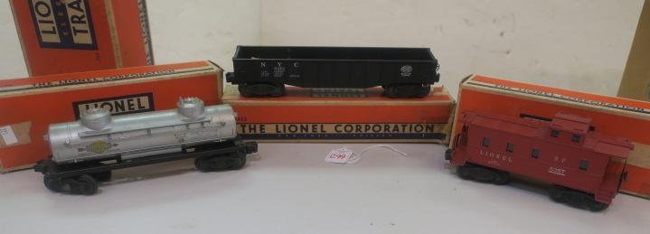 Two LIONEL Freight Cars and Caboose: