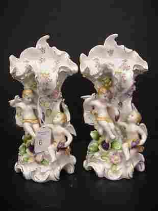 Pair of Handpainted Porcelain Figural Cupid Vases