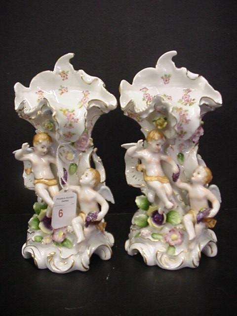 6: Pair of Handpainted Porcelain Figural Cupid Vases: