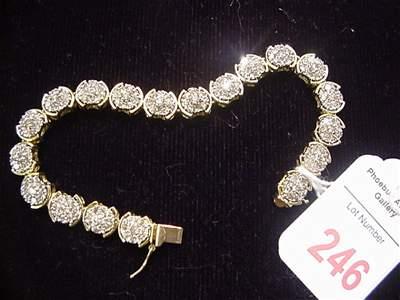 246: Ladies Customized Diamond and 14KT Gold Bracelet: